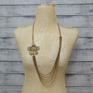 Gold rhinestone costume layered flower and chain